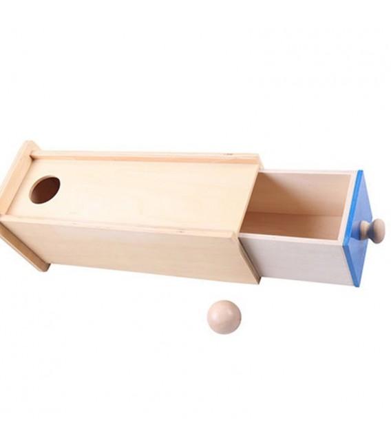Dlhá krabička so zásuvkou a guličkou